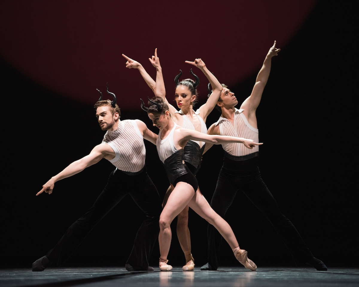A ballet dancer makes three bare hoes